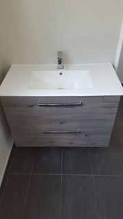 Wall-hung vanity fit-off after